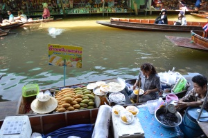 Selling Mango Sticky Rice at the floating market