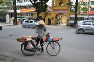 Woman carries goods for sale