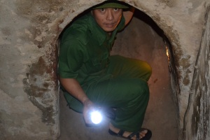The widened tunnel is still  small and narrow.  The Vietnamese did not have torches either.